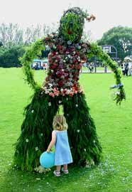 This giant willow sculpture, decorated with natural materials, was the centrepiece at a village Midsummer Party.